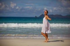Woman rests at beautiful seashore Royalty Free Stock Photos