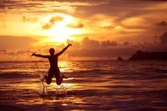 Woman rests at beautiful seashore Royalty Free Stock Image