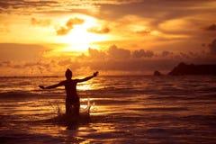 Woman rests at beautiful seashore Stock Images