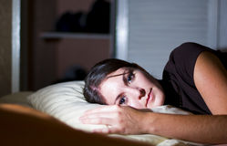 Woman rests in bed Royalty Free Stock Photography