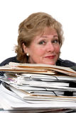 Woman rests chin on pile of paperwork Stock Photos