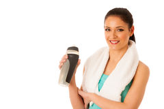 Woman rests after fitness workout with towel around her neck dri Royalty Free Stock Photography