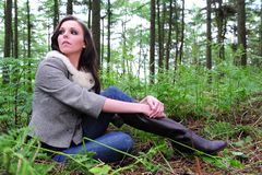 Woman rests in the forest Stock Photo