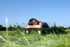 Woman rests on the green grass Stock Images