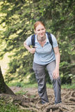 Woman Rests on Hiking Trail royalty free stock photography