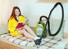 Woman rests from household chores Royalty Free Stock Photography