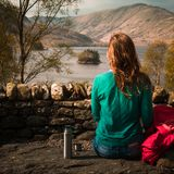 Woman Rests By a Loch. Woman Hiker Has a Tea Break With A View of a  Scottish Loch Stock Photography
