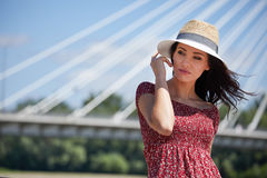 Woman  rests on the river in the city. Background bridge Royalty Free Stock Photography