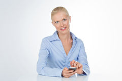 Woman rests on table on white background stock photo