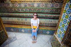 Woman rests while visiting King Palace in Bangkok, Thailand.  Stock Photo