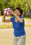 A woman of retirement age prepares to throw into a Hoop Stock Photos