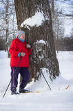 Woman retirement age, walking in winter forest Stock Images