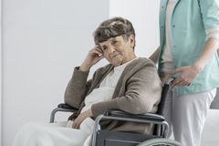 Woman in retirement club. Aged disabled women on a wheelchair in retirement club stock photo