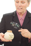 Woman with retirement fund. Jar surprised at how little it really is Royalty Free Stock Photos