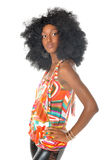 Woman in retro afro hairstyle. Black woman in retro afro hairstyle and colorful clothing.  Leather pants Royalty Free Stock Photography