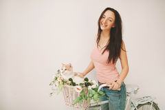Woman on retro bicycle with cat in basket Stock Photo