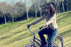 Woman with retro bicycle Stock Photo