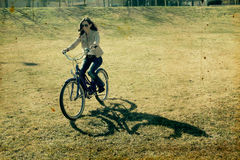 Woman with retro bicycle Stock Images