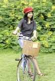 Woman with retro bicycle in a park Royalty Free Stock Images