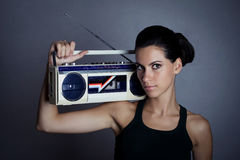 Woman with retro Boom Box Royalty Free Stock Image
