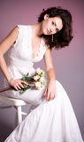 Woman in retro bridal dress Stock Photography