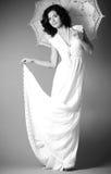 Woman in retro bridal dress with umbrella Royalty Free Stock Photos