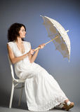 Woman in retro bridal dress with umbrella Royalty Free Stock Photos