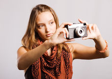 Woman with a retro camera Stock Photo