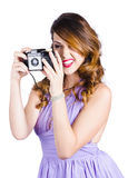 Woman with retro camera Stock Images