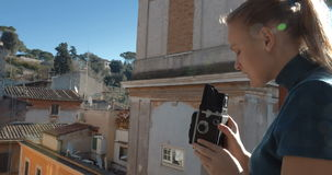 Woman with retro camera on the balcony stock video footage
