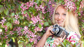 Woman with a retro camera Stock Photography