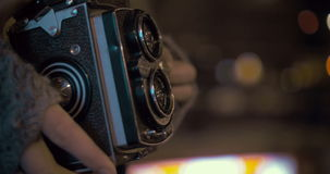 Woman with retro camera near entrance to subway stock video footage
