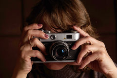 Woman with retro camera. Royalty Free Stock Photography