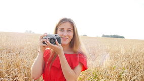 Woman with retro camera. Portrait happy pretty blonde woman with retro camera having fun in summer sunny day stock footage