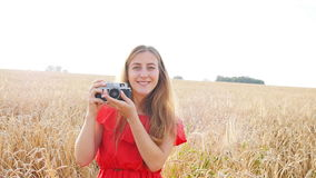 Woman with retro camera. Portrait happy pretty blonde woman with retro camera having fun in summer sunny day stock video footage