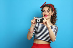 Woman with retro camera, wearing pin-up style Stock Photography