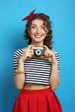 Woman with retro camera, wearing pin-up style Royalty Free Stock Images