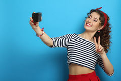Woman with retro camera, wearing pin-up style Stock Images