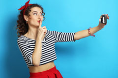 Woman with retro camera, wearing pin-up style Stock Photos