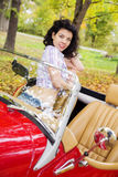 Woman at retro car on passanger seat Stock Photo