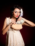 Woman in retro dress with dollars Stock Images