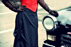 Woman in retro dress near the vintage car.  Stock Photos