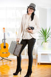 Woman with retro film camera and old suitcase Stock Photo