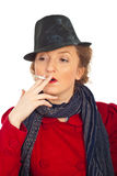 Woman with retro hat smoking Royalty Free Stock Photo