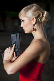 Woman in retro look with gun Stock Photos
