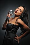 Woman with a retro microphone royalty free stock photography