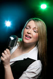 Woman with retro microphone Stock Photo