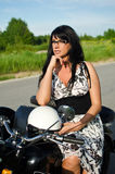 Woman on a retro motorcycle Stock Photo
