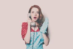 Woman with retro phone Royalty Free Stock Photography