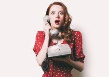Woman with retro phone Royalty Free Stock Image